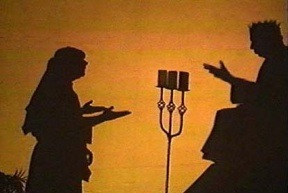 A shadow screen of two men dressed in Bible costumes.