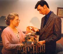 A man giving a key to a woman.