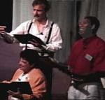 Three people read scripts in a Choral Reading.