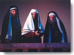 Three Pharisees looking down with judgement.