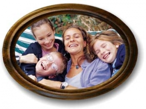 An oval framed picture of a single mom relaxing with her kids.