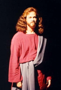 A close up of a man dressed as Jesus.