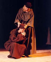 Two women, dressed in Bible costumes depicting Mary and Martha grieving the death of their brother.
