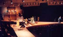 A wide shot of the middle stage ramp with dancers on it.