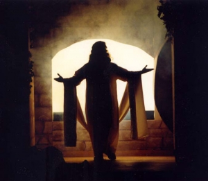 Jesus, silhouetted by the open tomb.