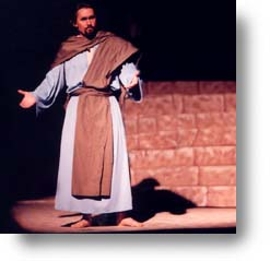 A man, dressed in Bible costume, portrays Judas.