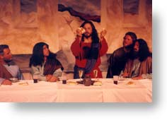 Jesus breaks the bread at the Last Supper.