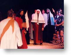 Jesus being questioned by Scribes and Pharisees.