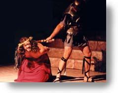 A Roman Solder beating Jesus.