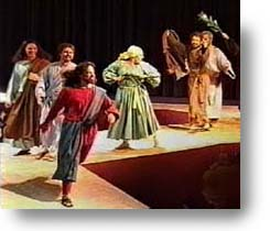 Jesus walking rapidly down the ramp with others who celebrate His coming!