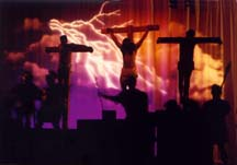 A dramatic image of the three crosses with lightning bolts.