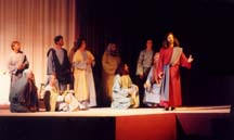 Jesus says Farewell to His disciples at stage edge.