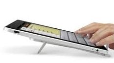 A tablet with fingers typing on it.