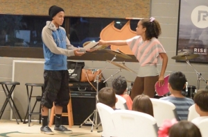 Youth minister to children by performing the SKITuations children's church skits.