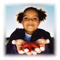 A 10 year-old girl holding a starfish.