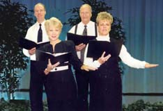 Four people read scripts in a Choral Reading.