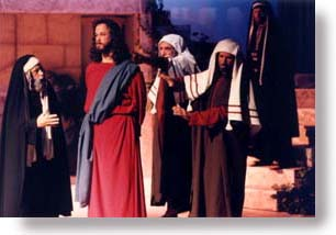 Jesus being accused by two Scribes and one Pharisee.