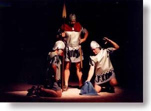 Three Roman guards gamble for Jesus' garment.
