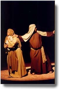 A man and woman, dressed in Bible costumes, flee to protect a baby.