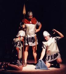 Three Roman guards gamble for Jesus' garment.