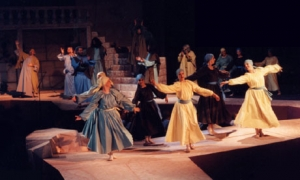 Dancers on a stage ramp.