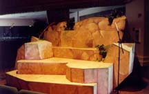 A close-up view of a stage platform built out of wood, called The Island.