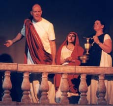 Pilate on the porch, motioning to Jesus.