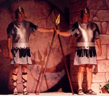 Two Roman soldiers guard the sealed tomb.