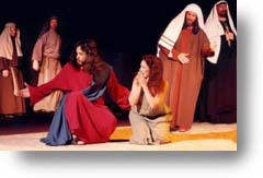 Jesus and the woman caught in adultery with religious leaders around them.