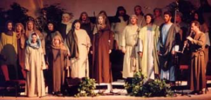 A group of singers, in Bible costumes, with Keith Ward playing his clarinet.