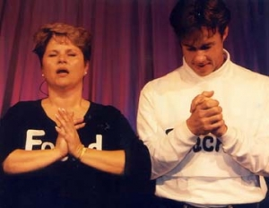 "The characters ""Teacher"" and ""Found"" praying with hands folded."